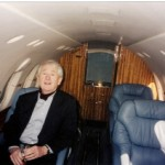 Frank, laughing at me, inside the private plane.