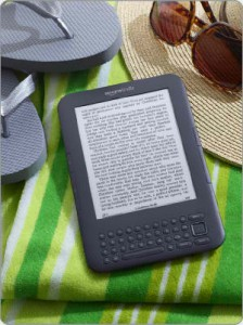 amazon kindle on beach towel