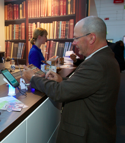A visitor at the Frankfurt Book Fair tries out an e-reading app on a tablet