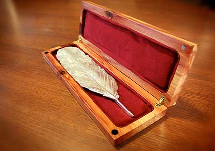 Neustadt International Prize for Literature awards a silver feather.