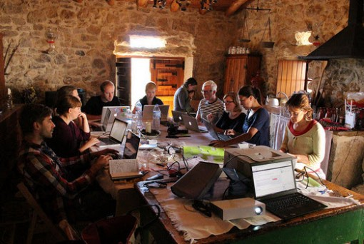 Participants in the first round of Book Sprints for ICT Research, participants work together in Mata Pequena, Portugal. Photo: Provided by Adam Hyde