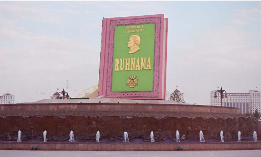 A giant copy of Ruhnama dominates the skyline of
