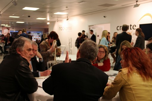 Dave Morris, center, back to camera, and Roz Morris, to his right, lead an Author Exchange workshop at London Book Fair