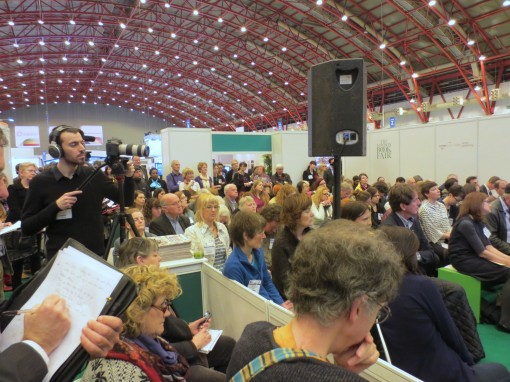 A crowd takes in a program inside the London Book Fair Author HQ pavilion, curated this year by MidasPR. Photo: Porter Anderson