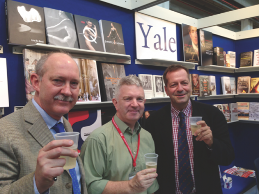 Robert Baldock, Noel Murphy and John Donatich from Yale University Press celebrate Modiano's win with a glass of champagne.