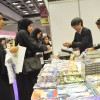 Busy trade in manga on the Kinokuniya stand.