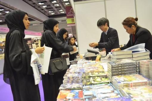 Busy trade in manga on the Kinokuniya stand.