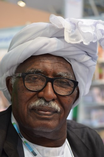 The fair is fabulous for faces. This man is from Sudan.