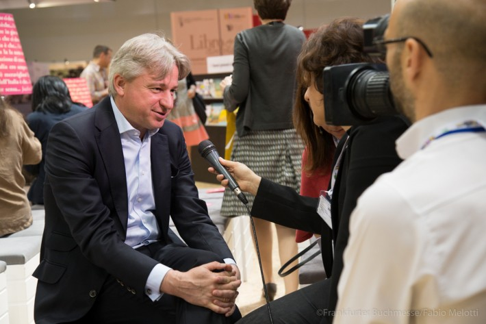 Juergen Boos gives an interview at the Turin Book Fair