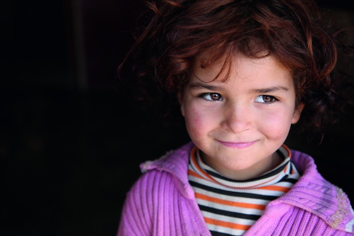 Tens of thousands of young Syrian children, like the one pictured, are in need.