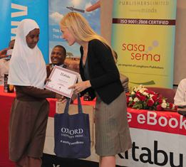 A winner of the eKitabu Essay contest receives her prize.