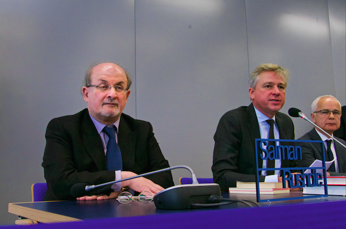 Salman Rushdie (left) at the opening press conference of the 2015 Frankfurt Book Fair with Juergen Boos, Director of the Frankfurt Book Fair (center) and Heinrich Riethmüller, Chairman of the German Booksellers and Publishers Association (right)