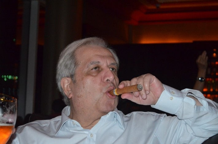 Nasser Jarrous enjoys one of his beloved Monte Cristo cigars.