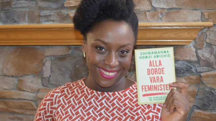 Adichie posing with the Swedish translation of We Should All Be Feminists