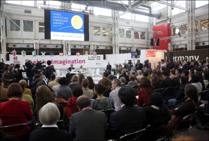 An audience at Bologna listens to the Hans Christian Andersen Award announcements. Image: Bologna Children's Book Fair