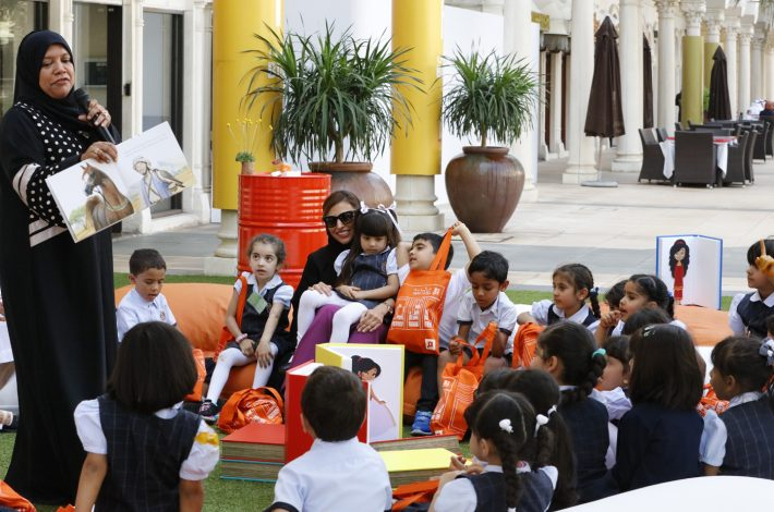 With young readers at Kalimat's launch of Maktaba, described a 'literary café that offers a unique environment to enrich the passion of reading.'