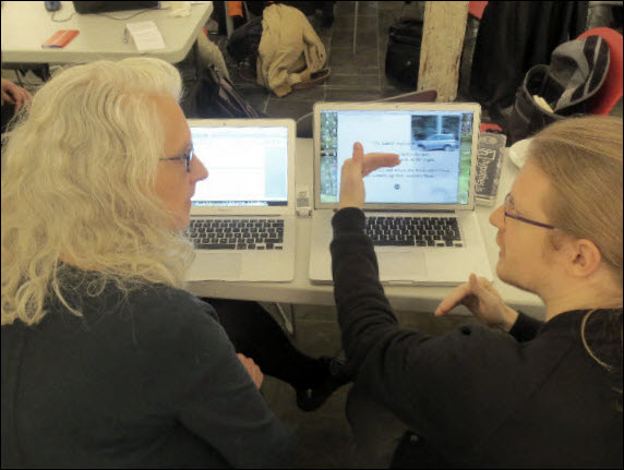 "London-based digital author and Bath Spa University professor Kate Pullinger and France's Dominique Cunin discuss a scene in Pullinger's ""Landing Gear"" at Books in Browsers' Hackday event, 2013. Image: Porter Anderson"