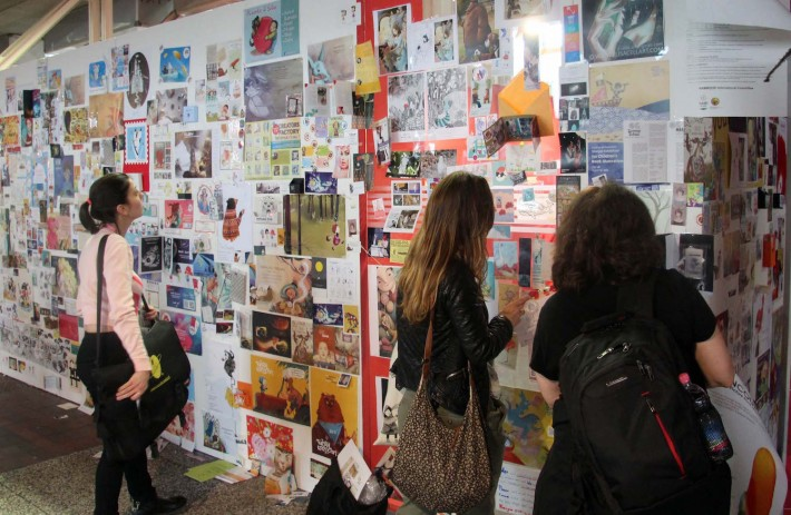 Visitors peruse the Illustrators Wall at the 2016 Bologna Book Fair (Image: Bologna Book Fair)
