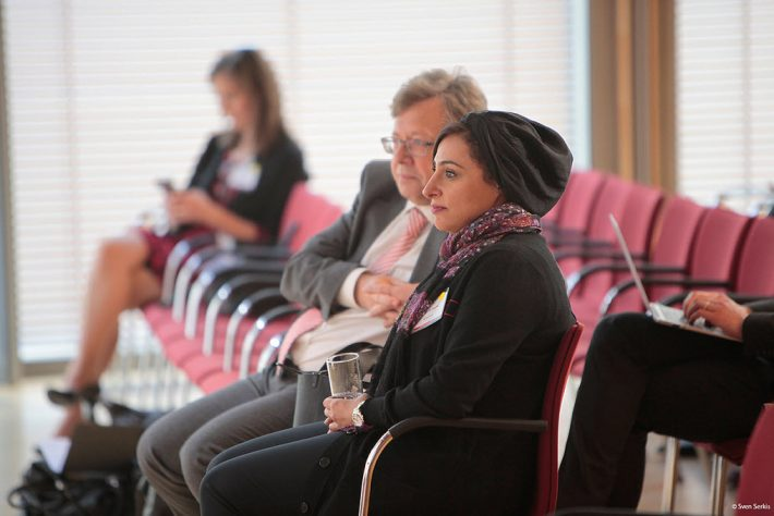 Bodour Al Qasimi and Rüdiger Wischenbart listen to speakers at Publishers' Forum in Berlin before their 'fireside chat.' Image: Sven Serkis
