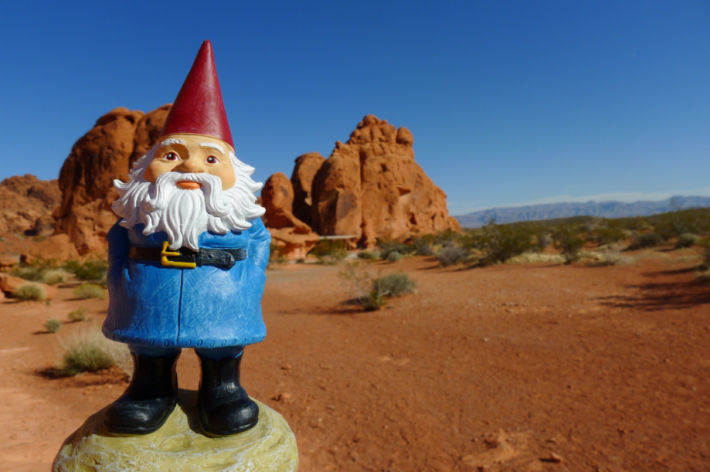 The Travelocity travel gnome may have something to say to the world publishing industry: 'Wander Wisely'. Image: PBS, January 2015, as Travelocity was acquired by Expedia.