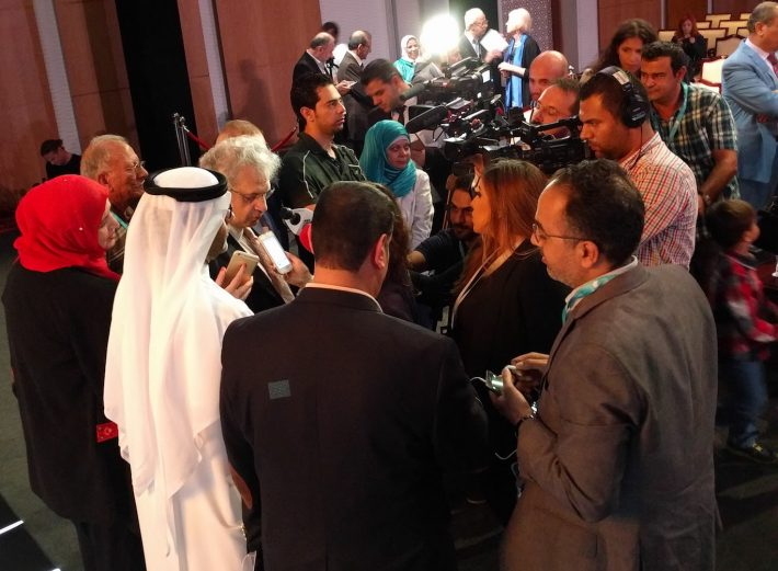 Amin Maalouf gives television interviews at the 2016 Sheikh Zayed Book Award