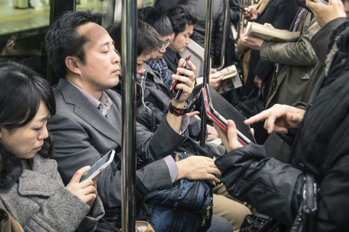 Train and book culture, says Alvin Lu, have contributed to a 'meteoric, dramatic' rise in phone-reading in Japan. Image - iStockphoto: ViewApart