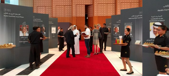 Amin Maalouf greets guests before the start of the 2016 Sheikh Zayed Book Award ceremony