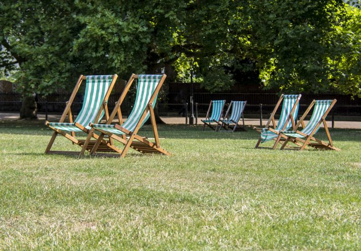 Deck chairs in summertime London's Green Park. Image - iStockphoto: Stuart Renneberg