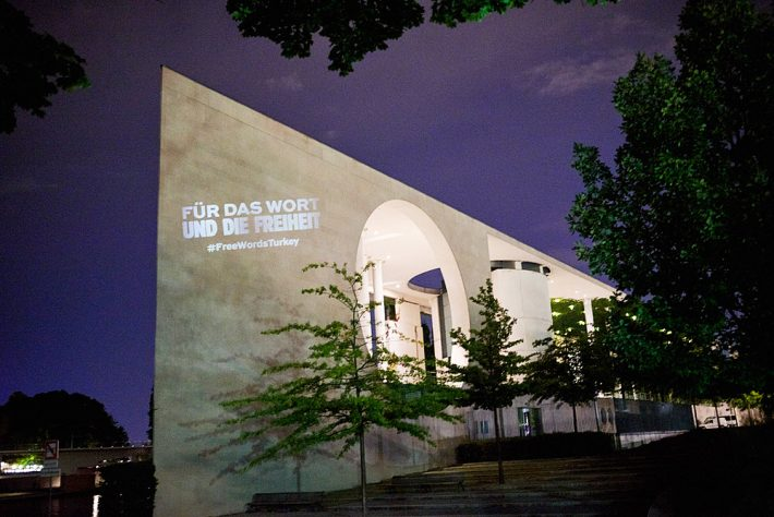 On Saturday evening, Germany's Chancellery was illuminated with the #FreeWordsTurkey message in association with the call to action from the German Publishers and Booksellers Association, PEN Center Germany, and Reporters Without Borders. Image: Börsenverein des Deutschen Buchhandels