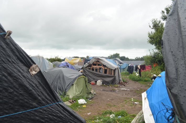 A reported 6,400 people were evicted from the Calais Jungle refugee camp in October. Image: Roger Tagholm