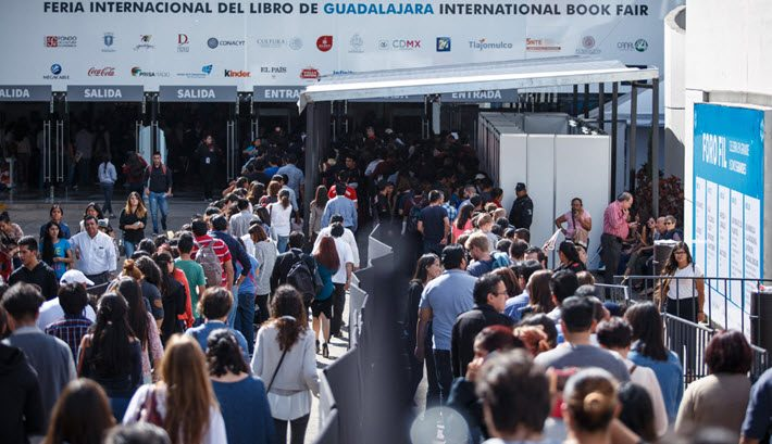 Fairgoers enter Guadalajara International Book Fair, which this year featured all of Latin America as its guest region. Image: Gilberto Torres